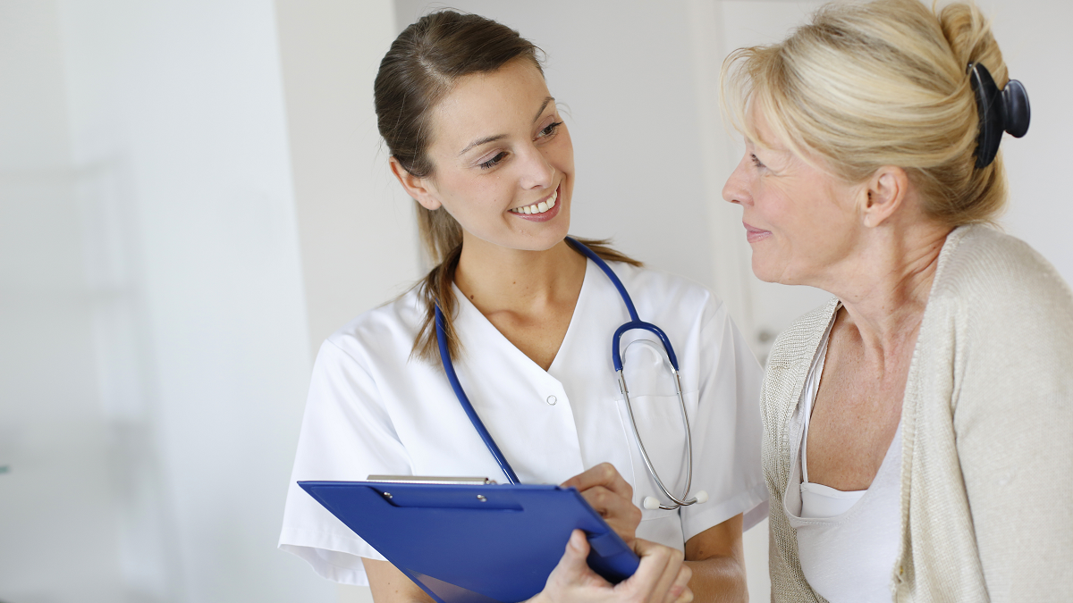 nurse practitioner talking to a patient