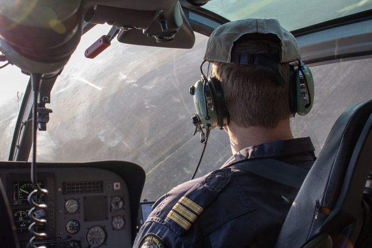 air traffic controller driving helicopter