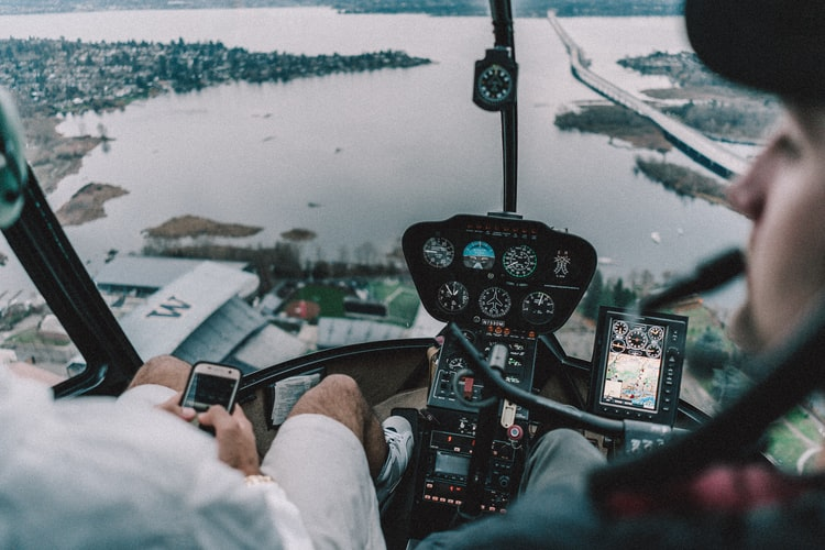 two persons riding helicopter